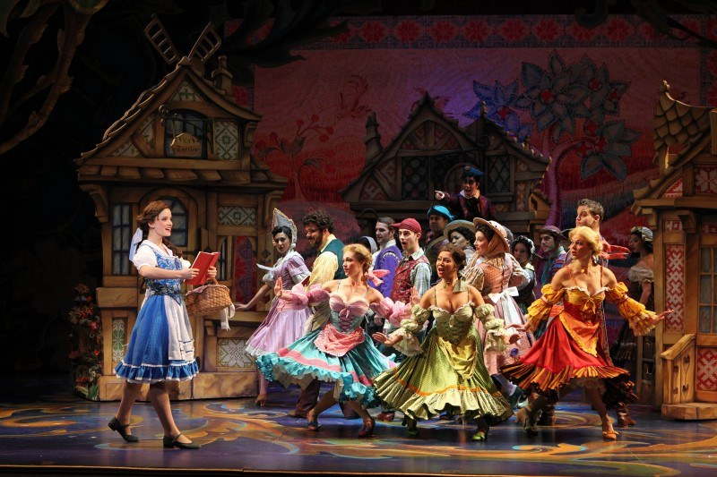 Belle (Emily Behny) and the Villagers in the Beauty & the Beast National Tour | Photo Credit: Joan Marcus