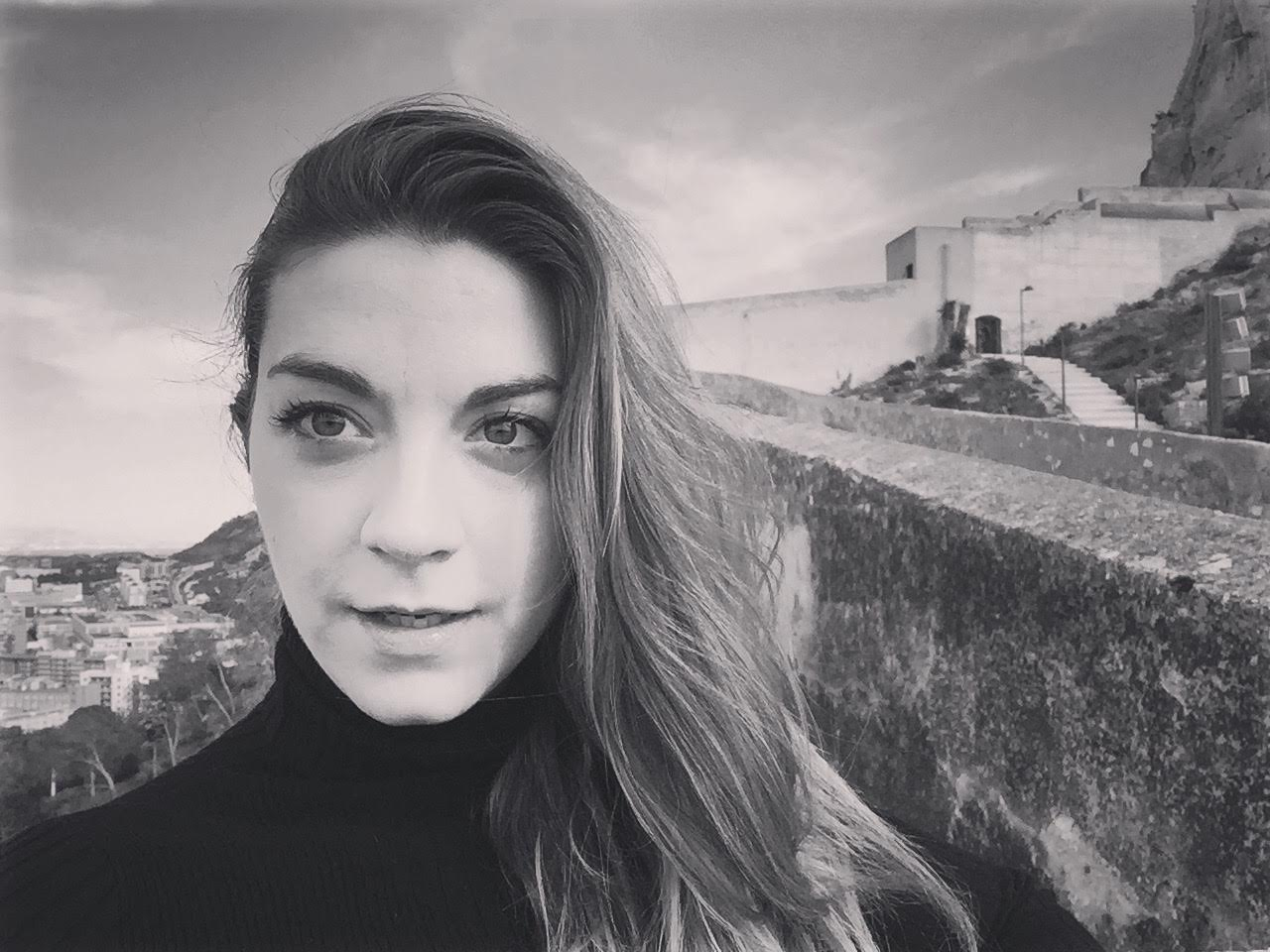 Mikaela Davies in front of Castle of Santa Bárbara in Alicante, Spain, where The Changeling is set.